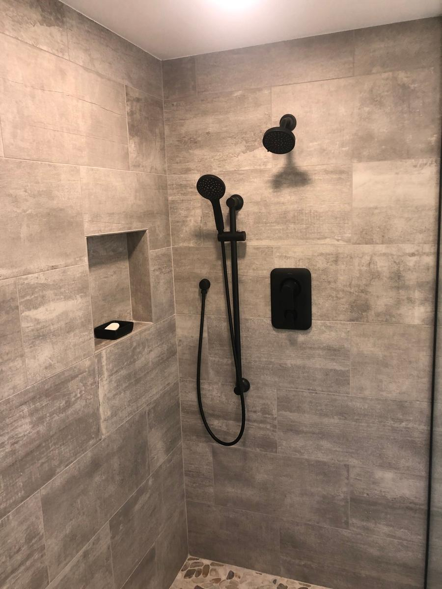 Contemporary Spa  walk in  shower, black shower accessories,River rock floor tile and tile plank walls, Stony brook NY
