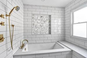 Marble hex patterned tile niche over bath tub