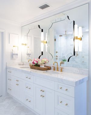 Tube sconce lighting along side double bathroom vanity mirrors